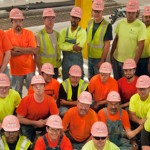 350+ Gibson Electric Construction Workers Wear Pink Hard Hats at Chicagoland's Job Sites